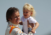 Dan Wheldon of England, driver of the #98 William Rast-Curb/Big Machine Dallara Honda with son, Sebastian Wheldon during the 95th Indianapolis 500 Mile Race Trophy Presentation at Indianapolis Motor Speedway on May 30, 2011 in Indianapolis, Indiana.