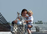 Dan Wheldon of England, driver of the #98 William Rast-Curb/Big Machine Dallara Honda poses with his son Sebastian and the Borg Warner Trophy on the day after winning the IZOD IndyCar Series Indianapolis 500 Mile Race at the Indianapolis Motor Speedway on May 30, 2011 in Indianapolis, Indiana.