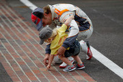 Dan Wheldon of England, driver of the #98 William Rast-Curb/Big Machine Dallara Honda, celebrates at the start/finish line with his son Sebastian after winning the IZOD IndyCar Series Indianapolis 500 Mile Race at Indianapolis Motor Speedway on May 29, 2011 in Indianapolis, Indiana.