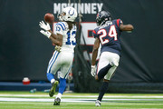 T.Y. Hilton #13 of the Indianapolis Colts catches a touchdown pass defended by Kurtis Drummond #23 of the Houston Texans in the first quarter at NRG Stadium on November 5, 2017 in Houston, Texas.