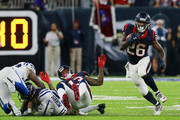 Lamar Miller #26 of the Houston Texans rushes up the middle as he receives a block from Braxton Miller #13 against the Indianapolis Colts at NRG Stadium on October 16, 2016 in Houston, Texas.