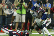 Jack Doyle #84 of the Indianapolis Colts is tackled by Kareem Jackson #25 of the Houston Texans as Kevin Johnson #30 misses on his tackle attempt at NRG Stadium on November 5, 2017 in Houston, Texas.