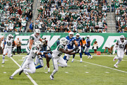 Cornerback Morris Claiborne #21 of the New York Jets makes a catch to run 17 yards for a touchdown against the Indianapolis Colts in the first quarter at MetLife Stadium on October 14, 2018 in East Rutherford, New Jersey.