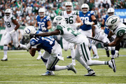 Wide receiver Marcus Johnson #16 of the Indianapolis Colts is tackled by cornerback Morris Claiborne #21 of the New York Jets during the first quarter at MetLife Stadium on October 14, 2018 in East Rutherford, New Jersey.