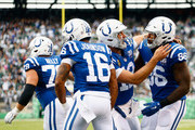 Tight end Erik Swoope #86 of the Indianapolis Colts celebrates with teammate quarterback Andrew Luck #12 after scoring a touchdown against the New York Jets during the fourth quarter at MetLife Stadium on October 14, 2018 in East Rutherford, New Jersey.