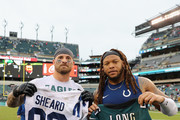 (L-R) Defensive end Chris Long #56 of the Philadelphia Eagles swaps jerseys with defensive end Jabaal Sheard #93 of the Indianapolis Colts after the Eagles 20-16 win at Lincoln Financial Field on September 23, 2018 in Philadelphia, Pennsylvania.