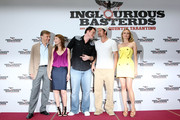 Actors Christoph Waltz, actress Melanie Laurent, director Quentin Tarantino and actors Brad Pitt and Diane Kruger attend the photo call for the Inglourious Basterds Germany Premiere at the Hotel Adlon on July 28, 2009 in Berlin, Germany.
