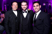 (L-R) Singer/songwriter Smokey Robinson, actor Chace Crawford, and manager Eric Podwall attend the 23rd Annual Elton John AIDS Foundation Academy Awards Viewing Party on February 22, 2015 in Los Angeles, California.