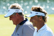 Colin Montgomerie of Scotland (L) walks with  Bernhard Langer of Germany to the 18th green during the final round of the Insperity Invitational at the Tournament Course at the Woodlands Country Club on May 4, 2014 in The Woodlands, Texas.