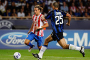 Walter Samuel (R) of Inter Milan and Diego Forlan of Atletico Madrid compete for the ball during the UEFA Super Cup between Inter and Atletico Madrid at Louis II Stadium on August 27, 2010 in Monaco, Monaco.