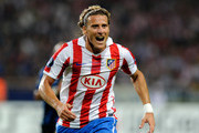 Diego Forlan of Atletico Madrid competes for the ball during the UEFA Super Cup between Inter and Atletico Madrid at Louis II Stadium on August 27, 2010 in Monaco, Monaco.