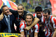 Diego Forlan of Atletico Madrid celebrates with team mates after winning the UEFA Super Cup between Inter and Atletico Madrid at Louis II Stadium on August 27, 2010 in Monaco, Monaco.