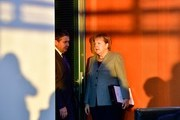German Chancellor Angela Merkel and German Vice Chancellor and Foreign Minister Sigmar Gabriel confer at the beginning of the weekly cabinet meeting in Berlin on December 13, 2017.   / AFP PHOTO / TOBIAS SCHWARZ