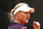 Kristina Mladenovic of France celebrates winning a point during her match against Caroline Garcia of France during day three of the International BNL d'Italia at Foro Italico on May 14, 2019 in Rome, Italy.