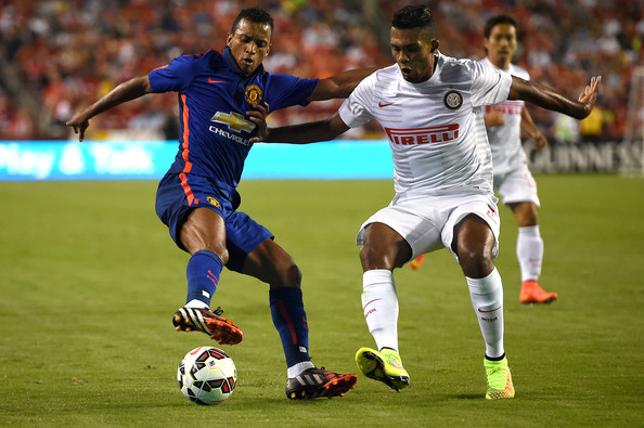 Nani #17 of Manchester United dribbles past Juan Jesus #5 of Inter Milan in the second half during their match in the International Champions Cup 2014 at FedExField on July 29, 2014 in Landover, Maryland. Manchester United won, 5-3, in a penalty shootout.