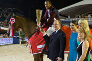 (L to R) Prince Albert II of Monaco, Charlotte Casiraghi, Katie Danby and Diane Fissore give the first prize to Hassan Bassem Mohammed during the Longines Grand Prix du Prince during the International Monte-Carlo Jumping at Port Hercule on June 28, 2014 in Monaco, Monaco.
