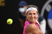 Victoria Azarenka of Belarus looks to play a backhand in her quarter-final match against Garbine Muguruza of Spain during day six of the Internazionali BNL d'Italia at Foro Italico on September 19, 2020 in Rome, Italy.