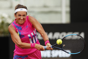 Victoria Azarenka of Belarus plays a backhand in her quarter-final match against Garbine Muguruza of Spain during day six of the Internazionali BNL d'Italia at Foro Italico on September 19, 2020 in Rome, Italy.