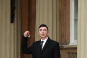 Soft Cell frontman Marc Almond holds his OBE following an investiture ceremony at Buckingham Palace on March 2, 2018 in London, England.