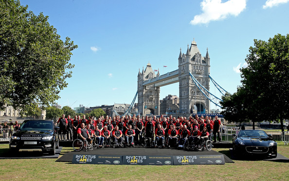 HRH Prince Harry with British Armed Forces team captain Dave Henson pose during the British Armed Forces team announcement for the Invictus Games at Potters Field on August 13, 2014 in London, England.