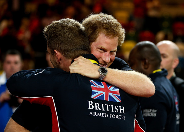 Prince Harry celebrates with Great Britain players after their victory in the final of the the Sitting Volleyball on day 4 of the Invictus Games at Olympic Park on September 14, 2014 in London, England.