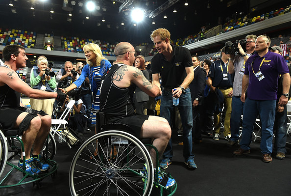Prince Harry congratulates the players during the Wheelchair Basketball match between United States and New Zealand on Day Three of Invictus Games at Olympic Park on September 13, 2014 in London, England.