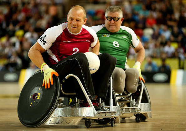 Mike Tindall of team Endeavour holds off pressure from Dennis Ramsay of team Invictus during Day Two of the Invictus Games at Olympic Park on September 12, 2014 in London, England.