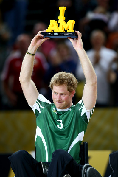 Prince Harry lifts the trophy after winning the Jaguar Land Rover Exhibition Wheelchair Rugby match during Day Two of the Invictus Games at the Olympic Park on September 12, 2014 in London, England.