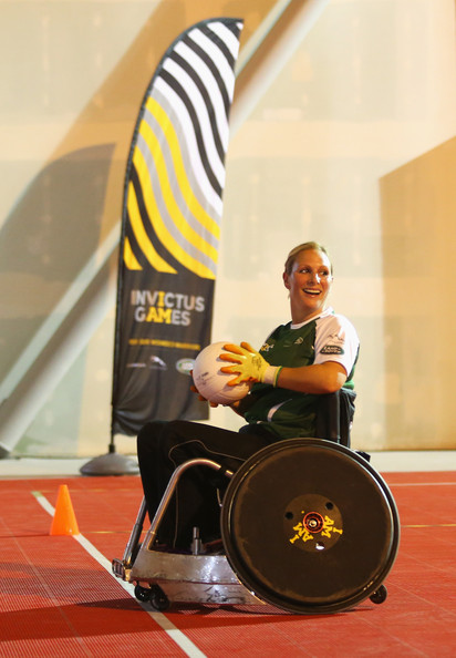 (STRICTLY EMBARGOED FOR PUBLICATION UNTIL 7PM BST) Zara Tindall carries the ball during a training session for the Jaguar Land Rover Exhibition Wheelchair Rugby Match on day 2 of the Invictus Games, presented by Jaguar Land Rover at Queen Elizabeth Olympic Park on September 12, 2014 in London, England.