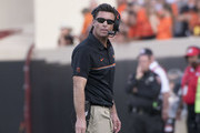 Mike Gundy coach of the Oklahoma State Cowboys watches game action final minutes of the second half of a NCAA football game against Iowa State at Boone Pickens Stadium on October 8, 2016 in Stillwater, Oklahoma.