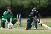Collins Obuya of Kenya sweeps the ball away from Rory McCann of Ireland during the ICC World Cricket League Division One match between Ireland and Kenya at the Rotterdam VOC on July 1, 2010 in Rotterdam, Netherlands.