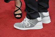 Susan Downey and Robert Downey Jr (shoe detail) attend a special screening of 'Iron Man 3' at Odeon Leicester Square on April 18, 2013 in London, England.