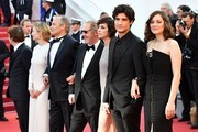 (FromR) French actress Marion Cotillard, French actor Louis Garrel, French actress Charlotte Gainsbourg, French director Arnaud Desplechin, French actor Hippolyte Girardot, Italian actress Alba Rohrwacher and French actor Mathieu Amalric pose as they arrive on May 17, 2017 for the screening of their film 'Ismael's Ghosts' (Les Fantomes d'Ismael) during the opening ceremony of the 70th edition of the Cannes Film Festival in Cannes, southern France.  / AFP PHOTO / Alberto PIZZOLI