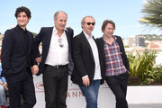 """(L-R) Actors Louis Garrel, Hippolyte Girardot, director Arnaud Desplechin and Mathieu Amalric attend the """"Ismael's Ghosts (Les Fantomes d'Ismael)"""" photocall during the 70th annual Cannes Film Festival at Palais des Festivals on May 17, 2017 in Cannes, France."""
