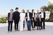"""(L-R) Actors Mathieu Amalric, Louis Garrel, Marion Cotillard, director Arnaud Desplechin, actors Charlotte Gainsbourg, Alba Rohrwacher and Hippolyte Girardot attend the """"Ismael's Ghosts (Les Fantomes d'Ismael)"""" photocall during the 70th annual Cannes Film Festival at Palais des Festivals on May 17, 2017 in Cannes, France."""