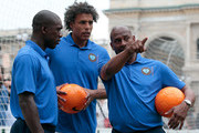 Aron Winter (R), Pierre van Hooijdonk (C) and Clarence Seedorf attend a football clinic for integration organized by Italian Football Federation on June 22, 2017 in Milan, Italy.