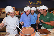 Gonzalo Fernandez Castano of Spain, Fredrik Andersson-Hed of Sweden, Alvaro Quiros of Spain and Matteo Manassero of Italy discover how Lindt chocolates are made after the pro-am prior to the start of the Italian Open golf at Circolo Golf Torino on September 18, 2013 in Turin, Italy.