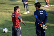 Head coach Antonio Conte (L) and Gianluigi Buffon during an Italy training session at Coverciano on September 02, 2015 in Florence, Italy.