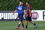Coach Italy Antonio Conte (R) and Stephan El Shaarawy during Italy Training Session at Coverciano on September 1, 2014 in Florence, Italy.
