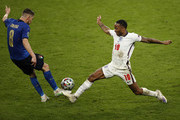 Jorginho of Italy is challenged by Raheem Sterling of England during the UEFA Euro 2020 Championship Final between Italy and England at Wembley Stadium on July 11, 2021 in London, England.