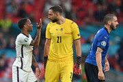 Raheem Sterling of England react towards Gianluigi Donnarumma of Italy during the UEFA Euro 2020 Championship Final between Italy and England at Wembley Stadium on July 11, 2021 in London, England.