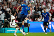 Giorgio Chiellini of Italy wins a header whilst under pressure from Raheem Sterling of England during the UEFA Euro 2020 Championship Final between Italy and England at Wembley Stadium on July 11, 2021 in London, England.