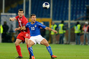 Aleksandar Lukovic of Serbia challenges Antonio Cassano of Italy during the UEFA Euro 2012 qualifying  match between Italy and Serbia at Luigi Ferraris Stadium on October 12, 2010 in Genoa, Italy.