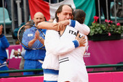 Flavia Pennetta of Italy celebrates a victory with team captain Corrado Barattuzzi during the Final of the Fed Cup World Group between Italy and the USA at Circolo Tennis Rocco Polimeni on November 7, 2009 in Reggio Calabria, Italy.