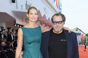 """Louise Kugelberg and Julian Schnabel walk the red carpet ahead of the """"J'Accuse"""" (An Officer And A Spy) screening during the 76th Venice Film Festival at Sala Grande on August 30, 2019 in Venice, Italy."""