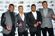 (L-R) Oritse Williams, Aston Merrygold, JB Gill and Marvin Humes of JLS attends a photocall to launch the new JLS female fragrance 'LOVE' at One Mayfair on January 31, 2013 in London, England.