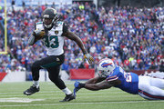 Chris Ivory #33 of the Jacksonville Jaguars evades a tackle and scores a touchdown during NFL game action against the Buffalo Bills at New Era Field on November 27, 2016 in Orchard Park, New York.