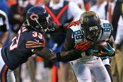 Charles Tillman #33 of the Chicago Bears knocks Allen Hurns #88 of the Jacksonville Jaguars out of bounds during a preseason game at Soldier Field on August 14, 2014 in Chicago, Illinois.  The Bears defeated the Jaguars 20-19.