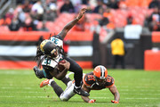 Chris Ivory #33 of the Jacksonville Jaguars dives over Jamar Taylor #21 of the Cleveland Browns in the second half at FirstEnergy Stadium on November 19, 2017 in Cleveland, Ohio.