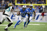 Darius Slay #23 of the Detroit Lions runs for yardage against Chris Ivory #33 of the Jacksonville Jaguars during first half action at Ford Field on November 20, 2016 in Detroit, Michigan.
